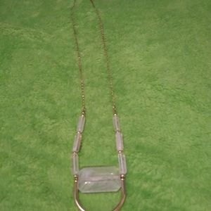 Gold & clear stone necklace with a horseshoe